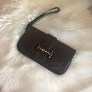 Ann Tylor brown leather wristlet with gold accent